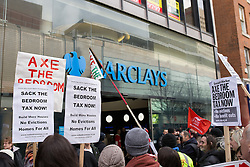 "© Licensed to London News Pictures . 16/03/2013 . Manchester , UK . Protesters gather outside Barclays Bank on Market Street chanting ""Pay your taxes"". Protesters opposed to changes to housing benefit , known as the Bedroom Tax , hold an impromptu (unsanctioned) march through Manchester City Centre today (16th March) . The government plans to introduce changes to housing benefit from this April which will see some claimants receive a reduced amount if they have excess living space . Photo credit : Joel Goodman/LNP"