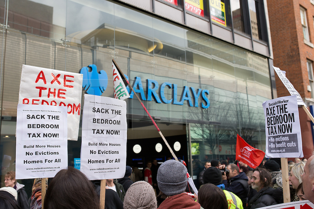 """© Licensed to London News Pictures . 16/03/2013 . Manchester , UK . Protesters gather outside Barclays Bank on Market Street chanting """"Pay your taxes"""". Protesters opposed to changes to housing benefit , known as the Bedroom Tax , hold an impromptu (unsanctioned) march through Manchester City Centre today (16th March) . The government plans to introduce changes to housing benefit from this April which will see some claimants receive a reduced amount if they have excess living space . Photo credit : Joel Goodman/LNP"""