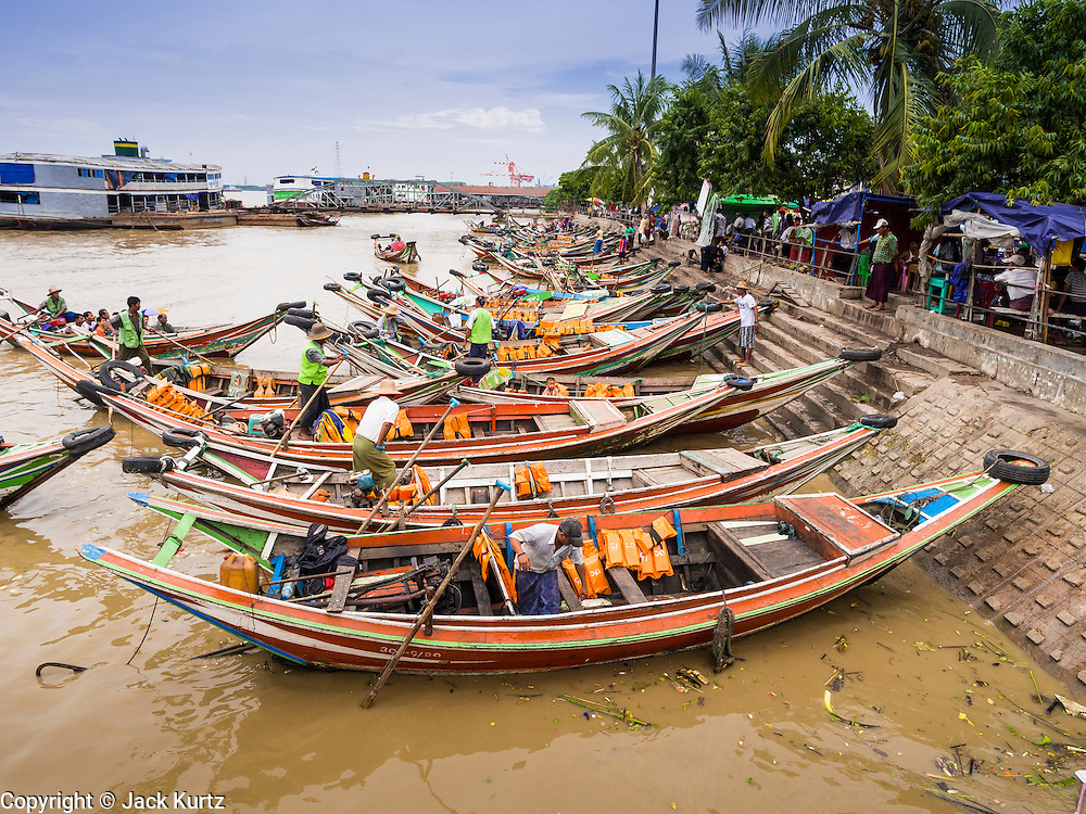 08 JUNE 2014 - YANGON, MYANMAR: Ferries wait for passengers on the Yangon River front in Yangon. Yangon, Myanmar (Rangoon, Burma). Yangon, with a population of over five million, continues to be the country's largest city and the most important commercial center.      PHOTO BY JACK KURTZ