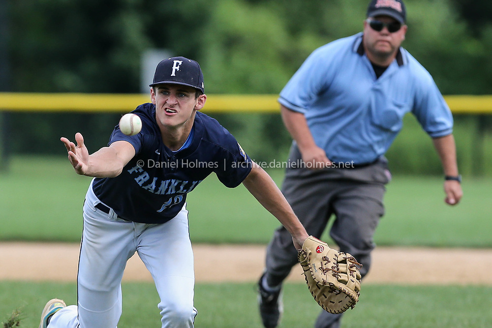 (7/16/17, FRANKLIN, MA) Franklin Post 75's Josh Macchi barehands a ball to the pitcher covering first base during the Zone 6 American Legion playoff game against Canton Post 24 at Franklin High School on Sunday. [Daily News and Wicked Local Photo/Dan Holmes]
