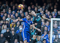 Football - 2016 / 2017 Premier League - Chelsea vs. WBA<br /> <br /> Diego Costa of Chelsea and Jonny Evans of West Bromwich Albion in the air at Stamford Bridge.<br /> <br /> COLORSPORT/DANIEL BEARHAM