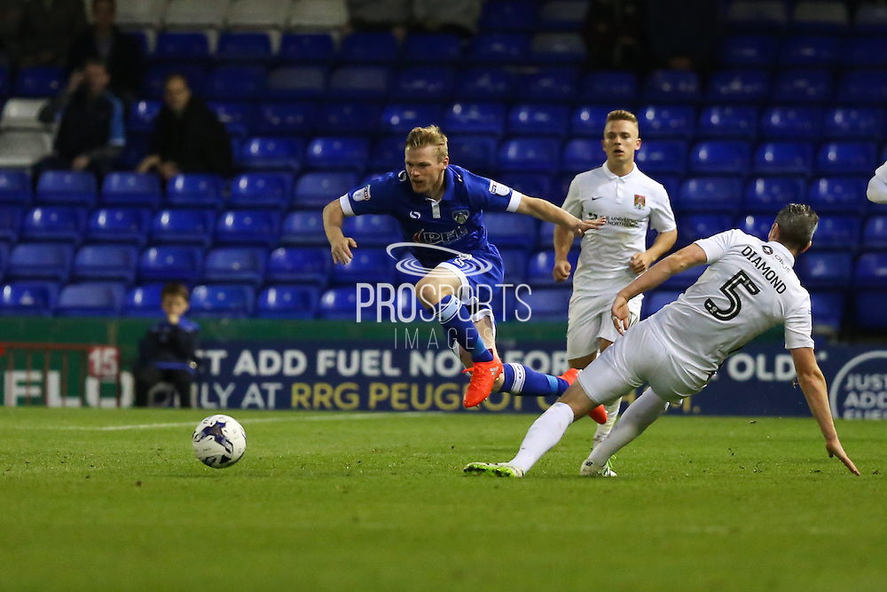 Zander Diamond of Northampton Town fouls Billy McKay of Oldham Athletic during the EFL Sky Bet League 1 match between Oldham Athletic and Northampton Town at Boundary Park, Oldham, England on 16 August 2016. Photo by Simon Brady.
