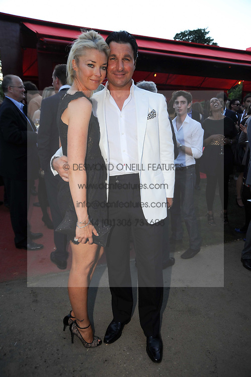 GEORGIO VERONI and hsi wife TAMARA BECKWITH at the annual Serpentine Gallery Summer party this year sponsored by Jaguar held at the Serpentine Gallery, Kensington Gardens, London on 8th July 2010.  2010 marks the 40th anniversary of the Serpentine Gallery and the 10th Pavilion.