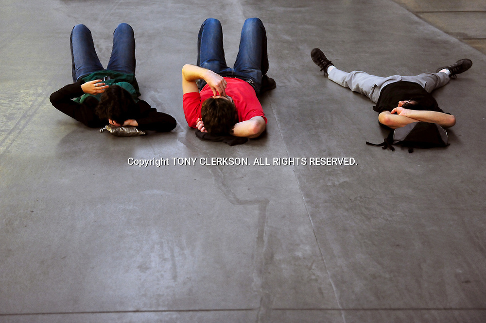Visitors to the Tate Modern relax in the Turbine Hall