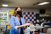 14 JULY 2020 - ADEL, IOWA: THERESA GREENFIELD uses hand santizer in the entry way of the Adel Family Fun Center, a bowling alley in Adel, IA, about 25 miles west of Des Moines. The owner put out the hand sanitzer for customers to follow CDC guidelines. Theresa Greenfield, a Democrat, is running for the US Senate against incumbent Senator Joni Ernst. Recent polls have Greenfield slightly ahead of or statistically tied with Ernst, who is closely allied with President Donald Trump. This was one of Greenfield's first live campaign events since the Coronavirus pandemic shutdown started in March. She has been campaigning virtually using teleconferencing apps.      PHOTO BY JACK KURTZ