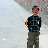 """Asia, China, Beijing. Young boy stands in scene of the """"Last Emperor"""" at the Forbidden Palace in Beijing;"""