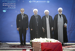 TEHRAN, Oct. 3, 2015 (Xinhua) -- Iranian President Hassan Rouhani (2nd L) delivers a speech during a ceremony to pay tribute to 104 Iranian pilgrims killed in the latest Hajj stampede and transferred to Mehrabad airport in Tehran, capital of Iran, on Oct. 3, 2015. Rouhani on Saturday urged for an investigation into the latest Hajj stampede in Saudi Arabia which left 465 Iranian pilgrims dead. (Xinhua/Ahmad Halabisaz) (Credit Image: © Ahmad Halabisaz/Xinhua via ZUMA Wire)
