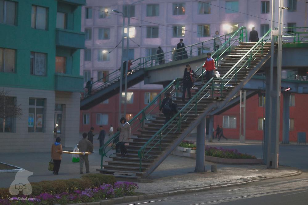 Pedestrians on an overpass, Pyongyang, North Korea.