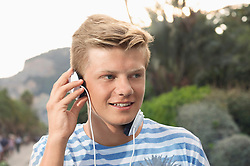 Close-up portrait male teenager music MP3 player