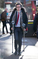 © Licensed to London News Pictures. 28/01/2019. London, UK. Broadcaster Robert Peston is seen walking near Parliament with the aid of crutches. Photo credit: Peter Macdiarmid/LNP