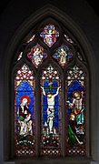 Stained glass window of crucifixion Church of Saint John the Baptist, Pewsey, Wiltshire, England, UK 1861 by Hardman