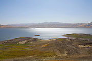 """The San Luis Reservoir is a water-storage """"off-stream"""" reservoir and is typically low in late summer due to its heavy usage for irrigation, Merced County, California, USA"""