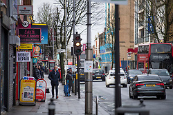 © Licensed to London News Pictures. 02/02/2021. London, UK. A view of the Broadway in West Ealing, West London, where a new South African variant of coronavirus has ben discovered. Door-to-door delivery of free home test kits is to start in the area in an attempt to slow the spread of the more aggressive strain of the virus. Photo credit: Ben Cawthra/LNP