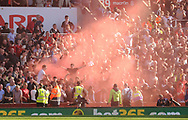 Liverpool fans set off a flare.  Premier league match, Stoke City v Liverpool at the Bet365 Stadium in Stoke on Trent, Staffs on Saturday 8th April 2017.<br /> pic by Bradley Collyer, Andrew Orchard sports photography.