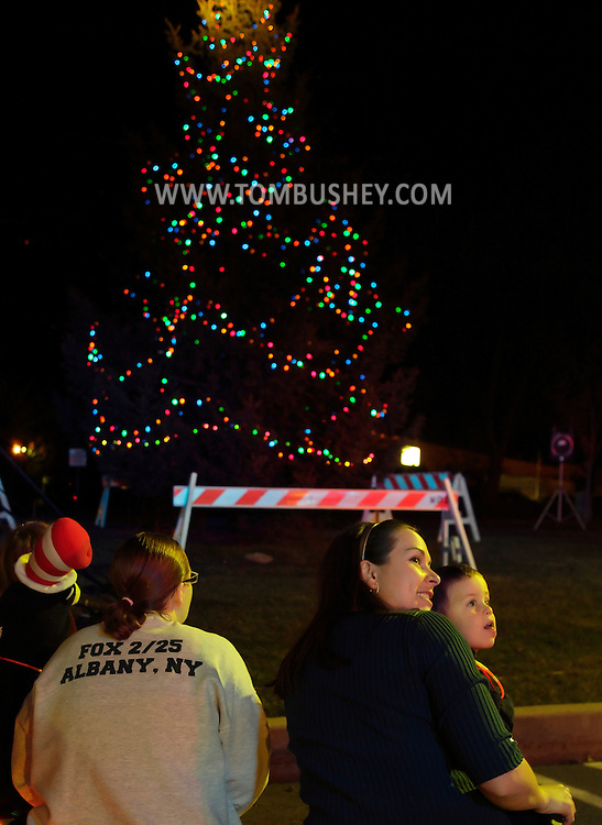 Town of Wallkill, New York  - Parents and children watch the Holiday Parade and Tree Lighting in front of Town Hall on Saturday, Nov. 26, 2012.
