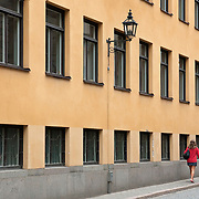 Couple walking in Gamla Stan, Stockholm, Sweden