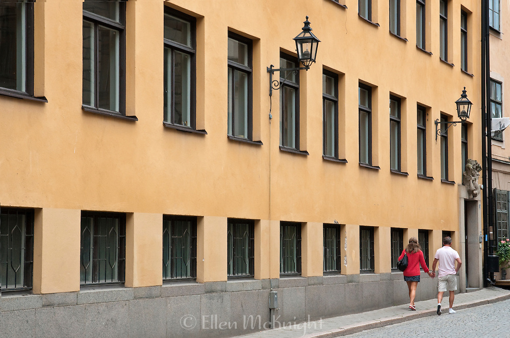 Couple walking in Gamla Stan, Stockholm, Sweden