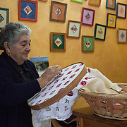 """A woman practices traditional Cilaos embroidery, a style called """"Broderie de Cilaos"""" that is unique to the village of Cilaos"""