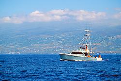 sport fishing boat, .trolling in front of Hualalai mountain, .Kona, Big Island, Hawaii (Pacific).