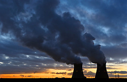 Cooling towers vent steam, at the Port of Antwerp, in Antwerp, Belgium. (Photo © Jock Fistick)