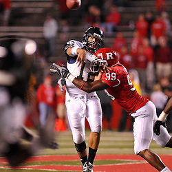 Sep 19, 2009; Piscataway, NJ, USA; Florida International quarterback Paul McCall (12) makes a pass while being hit by Rutgers defensive end Jonathan Freeny (99) during the second half of Rutgers' 23-15 victory over Florida International at Rutgers Stadium.