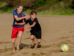 Girls playing with soccer ball on the arrigunaga beach