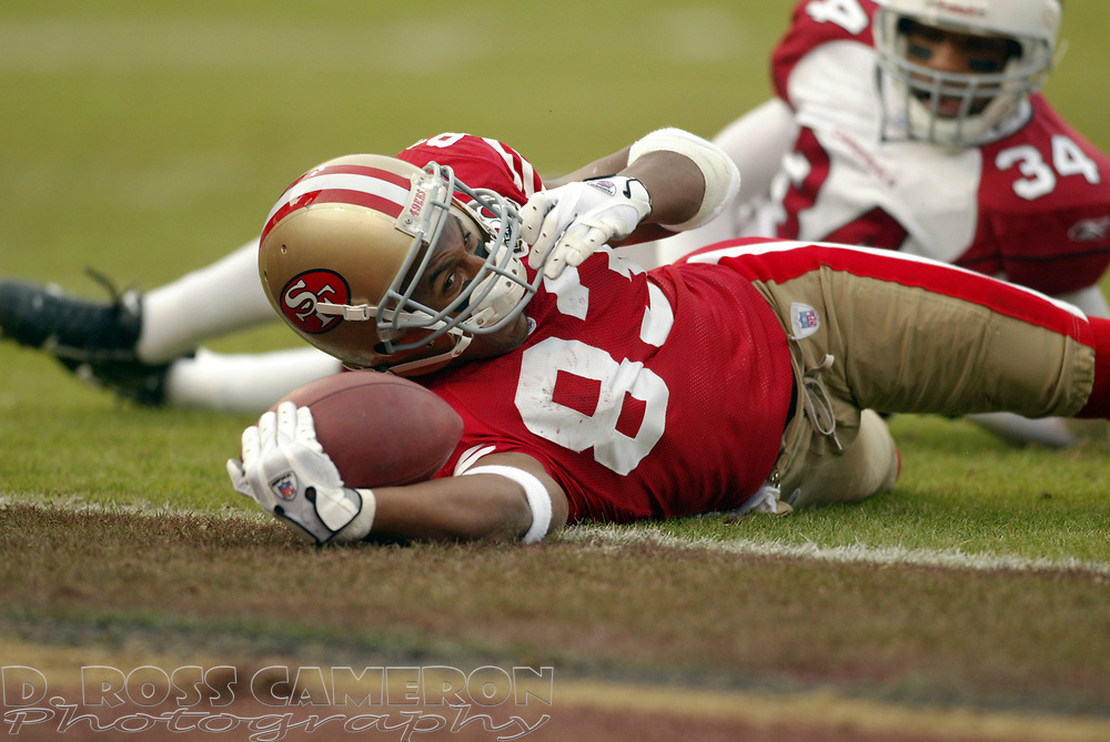 San Francisco 49ers wide receiver Arnaz Battle (83) reaches the ball across the goal line as Arizona Cardinals defender Robert Griffith watches in the fourth quarter of their NFL football game, Sunday, Dec. 24, 2006 at Candlestick Park in San Francisco.  The Cardinals won, 26-20. Battle was judged down on the 1-yard line, but the 49ers scored on the next play. (D. Ross Cameron/The Oakland Tribune)