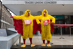© Licensed to London News Pictures. 19/10/2017. LONDON, UK.  Two Royal Mail workers dressed as chickens prepare to take part in the Communication Workers Union (CWU) protest march from the Trade Union Congress (TUC) Headquarters to Mount Pleasant Delivery Office as part of the long running pensions dispute.  Photo credit: Vickie Flores/LNP