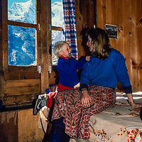 Mother and son trekkers relax at Khumbu Lodge in a room where Jimmy Carter once stayed while visiting Namch Bazar in the Khumbu region of Nepal 1986.