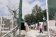Amongst the barbed wire, asylum seekers live in a variety of shelters in the Moria refugee camp, home to approximately 5000 people from around the world, seeking refuge in Europe. Lesvos island, Greece.