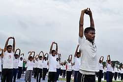 June 21, 2017 - Kolkata, west bengal, India - Kolkata, West Bengal, India : On 21st June, International Yoga day, people gathered at maidan in early morning to perform yoga under the supervision of NCC. More than two hundred people from children to senior citizens joined  the program to celebrate world yoga day with the notion of healthy life. (Credit Image: © Debsuddha Banerjee via ZUMA Wire)