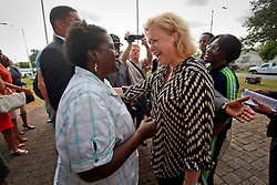 29 August 2014. Lower 9th Ward, New Orleans, Louisiana. <br /> Senator Mary Landrieu with local resident Margie Shorty and  hurricane Katrina survivors at the official memorial in remembrance of the day Hurricane Katrina swamped the community 9 years ago today..<br /> Photo; Charlie Varley/varleypix.com