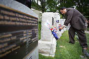 City officials place wreaths on the Veterans Memorial Plagues during the Milpitas Memorial Day Ceremony at Veterans Memorial Flag Plaza in Milpitas, California, on May 27, 2013. (Stan Olszewski/SOSKIphoto)