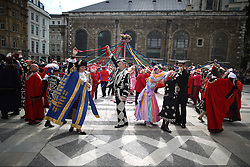 © Licensed to London News Pictures. 27/09/2015. London, UK. Pearly Kings and Queens dance round the Maypole with London Borough Mayors and other dignitaries in Guildhall Square during a Harvest Festival celebration. Photo credit: Peter Macdiarmid/LNP