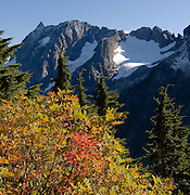 Mountain peaks and glaciers rise high above the wild Stehekin Valley in North Cascades National Park, Washington, USA.