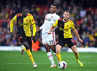 Football - 2019 / 2020 Premier League - Watford vs. Sheffield United<br /> <br /> Abdoulaye Doucoure and Tom Cleverley mussel out Lys Mousset of Watford  at Vicarage Road.<br /> <br /> COLORSPORT/ANDREW COWIE