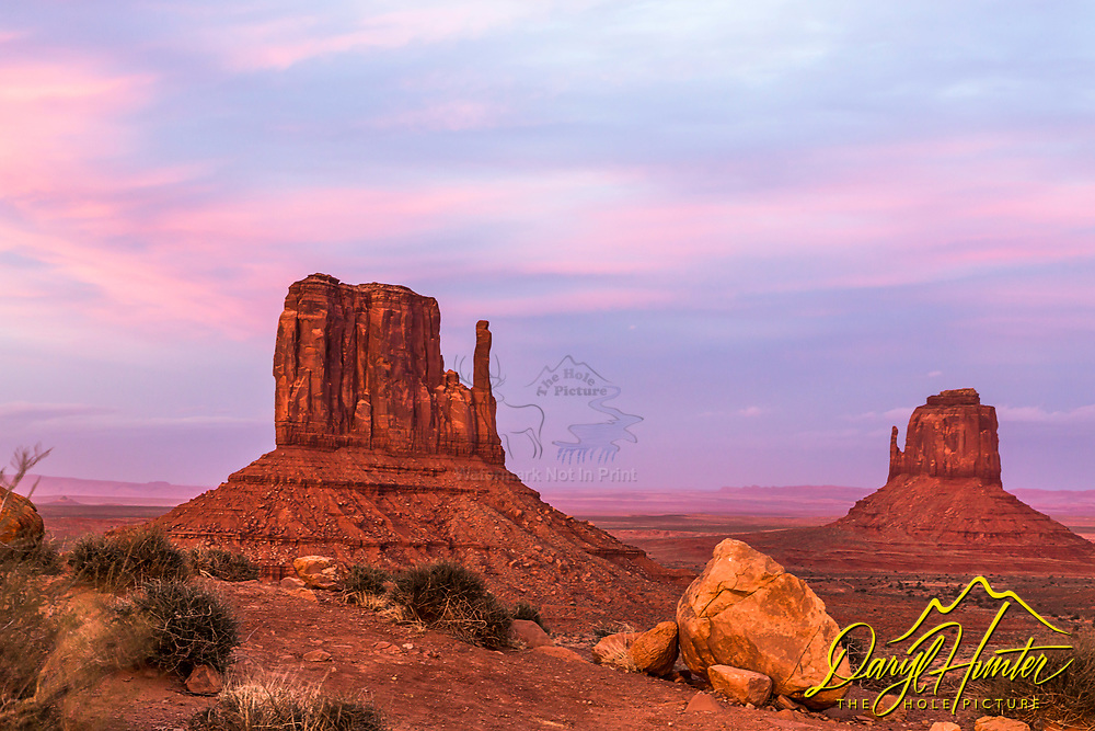 Sunset at the Twin Mittens in Monument Valley Arizona. The skies of the American Southwest are worth the trip out there, the wind sculptures of the Colorado Plateau's sandstone is the icing on the cake.  Many movies have been made in this iconic landscape