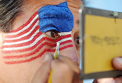June 26, 2014 - Rio De Janiero, Brazil - A USA supporters paints his face with the colours of the national flag at the Rio De Janeiro Fan Fest in Copacabana before the match between Germany and the USA during the FIFA 2014 Brazil World Cup. (Credit Image: © Daniel Dal Zennaro/ANSA/ZUMAPRESS.com)