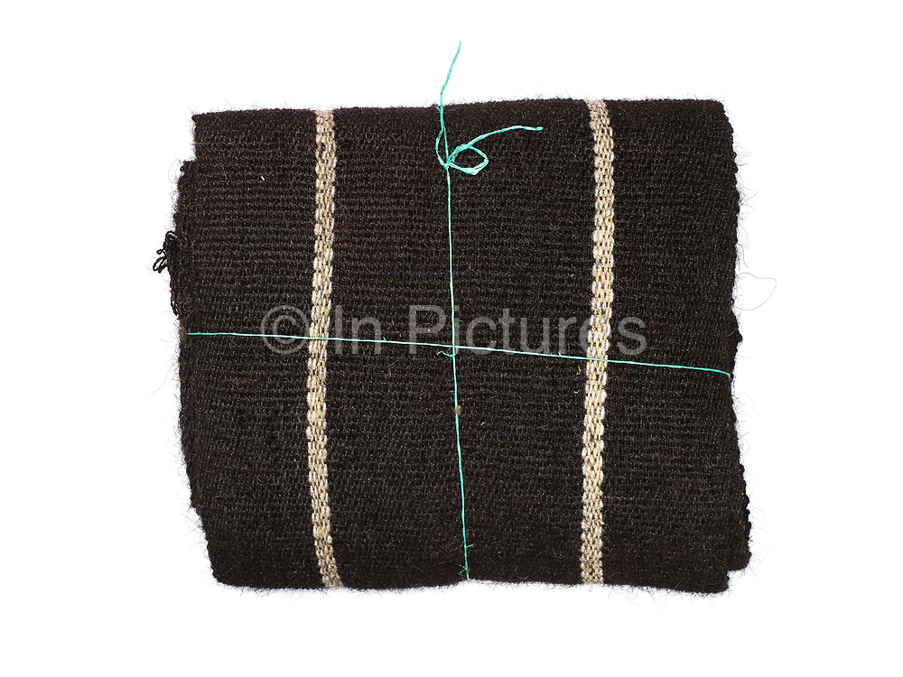 A roll of Brokpa handwoven yak hair fabric from the village of Merak in the extreme northeast region of Bhutan. The Brokpa are a semi-nomadic tribe whose source of livelihood is dependent on yaks and sheep, the products of which they barter with the Tshanglas of neighbouring villages for their necessities.