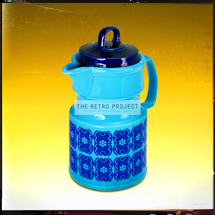 Vintage Blue Coffee Pot on Graduated orange studio background