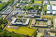 Nederland, Noord-Brabant, Vught, 13-05-2019; PI Vught - Penitiaire Inrichting Vught, overzicht, het complex huisvest onder andere de gevangenis, Huis van Bewaring (HvB) en Extra beveiligde inrichting (EBI), boven - midden. Verder op het terrein Inrichting voor Stelselmatige Daders (ISD), , Terroristen Afdeling (TA), Beheersproblematische Gedetineerden (BPG), Langdurige Forensische Psychiatrische Zorg (LFPZ), Zeer intensieve Specialistische Zorg (ZISZ) als een Penitentiair Psychiatrisch Centrum (PPC).<br /> Prison complex Vught.