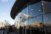 Reflections of blue sky and clouds and St Pauls Cathedral in a window at a cafe in Blackfriars station on 12th January 2020 in London, England, United Kingdom.