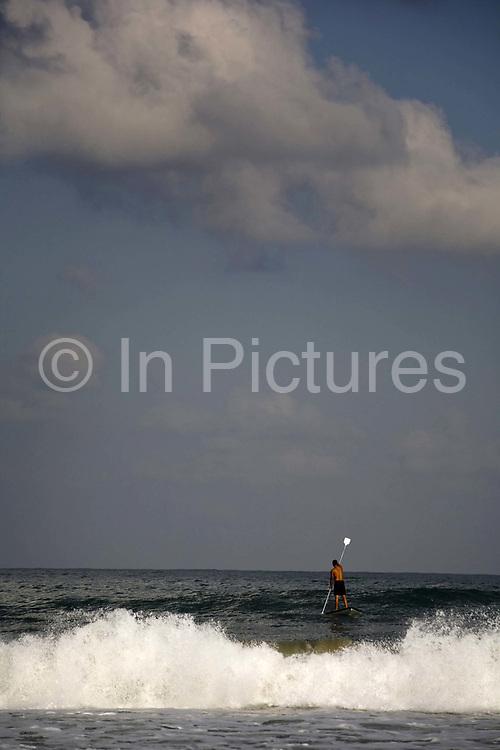 Israeli flags in bunting fly over the beach, Tel, Aviv, Israel