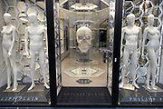 Nakedmannequins and a diamond human skull in a closed shop window on Bond Street as Londoners await the imminent end of the second coronavirus national lockdown before the capital enters tier two in the new three tier system on 1st December 2020 in London, United Kingdom. Non essential shops will be allowed to reopen as of 2nd December while in other areas of the country, controversially, they will have to remain closed.