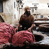 """Fes el Bali, Morocco, 26 October 2006<br /> Leather dyeing vats. (also """"Quartier des Tanneurs"""" / """"The Tanneries"""")<br /> Fes or Fez is the third largest city in Morocco, after Casablanca and Rabat. <br /> It is one of the four so-called """"imperial cities"""".<br /> The Medina of Fes is believed to be the largest contiguous car-free urban area in the world. <br /> Fes el Bali is classified as a UNESCO World Heritage Site.<br /> Photo: Ezequiel Scagnetti"""