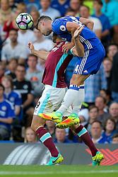Gary Cahill of Chelsea challenges Andy Carroll of West Ham United - Rogan Thomson/JMP - 15/08/2016 - FOOTBALL - Stamford Bridge Stadium - London, England - Chelsea v West Ham United - Premier League Opening Weekend.