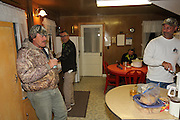 (L-R) Miles Ward, Mike Brandriet, Sam Brandriet, and Keith Van Beusekom in the kitchen of York Lodge on the Delta Marsh in Manitoba, Canada