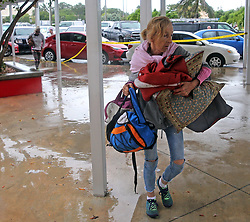 A Key West resident carries bedding and supplies into a shelter at Key West High School in Key West, FL, USA., on Saturday, September 9, 2017. Hurricane Irma is approaching the Florida Keys, with many residents refusing to be evacuated. Photo by Charles Trainor Jr./Miami Herald/TNS/ABACAPRESS.COM