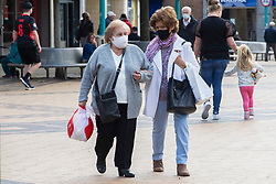 © Licensed to London News Pictures. 26/09/2020. Knowsley, UK. People walk through the high street of Huyton in Knowsley. Knowsley now has the highest infection rate in England. Photo credit: Kerry Elsworth/LNP