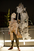 New York, NY - 30 April 2012. A sweeper, festooned with pages of text, gets ready for the start of the parade.